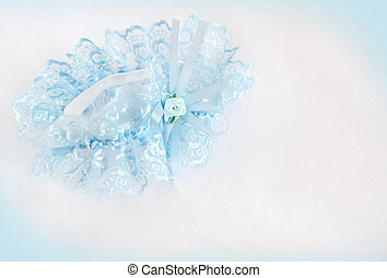 Wedding background with  blue bridal garter on the down