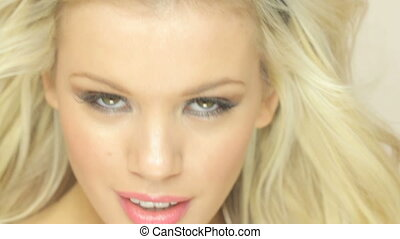 Smiling Seductive Blonde Woman, headshot facing camera