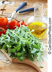 ingredients for the salad tomato and arugula on the kitchen...