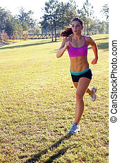 Beautiful Brunette Jogging Outdoors - A lovely young athlete...