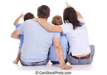 family backs on white - portrait of a family backs on white