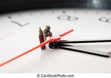 Miniature Welder At Work. A miniature figurine of a welder...