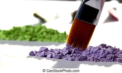 Paintbrush mixing violet paint Art studio shot Closeup,...
