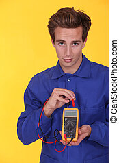 Electrician using a multimeter