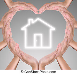 house icon in heart hand