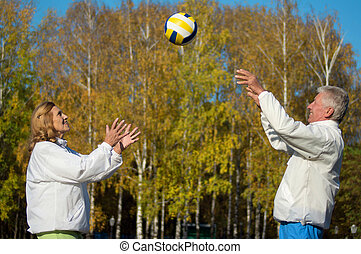 old people playing with ball