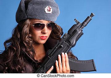 Woman with gun - Beautiful young Russian woman holding an...