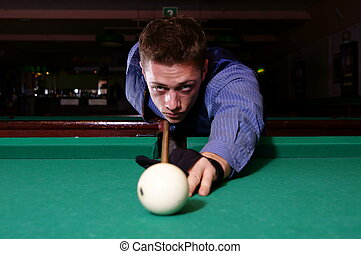 billiard at table - portrait of a young man playing...