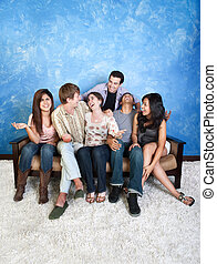 Happy Friends - Group of six laughing friends on couch