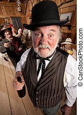 Drunk Man in an Old West Saloon - Bearded gentleman caught...