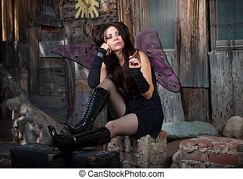 Lonely Fairy - Lonely Caucasian fairy sits on bricks and...
