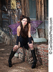 Fairy Wondering - Serious fairy relaxes in rustic scene with...
