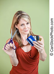 Cutting Credit Cards - Mature Caucasian woman with scissors...
