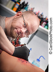 Tattoo Artist With Client