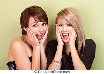 Two attractive teen girls screaming - Two attractive teen...
