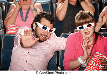 Couple With 3D Glasses - Scared Caucasian couple with 3D...