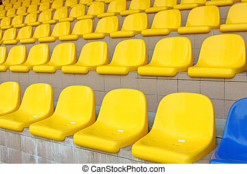 Stadium seats in blue and yellow color