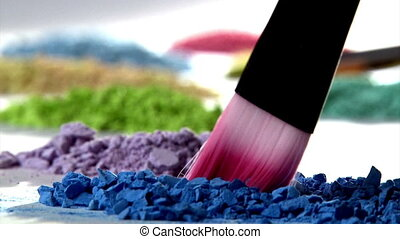 Paintbrush mixing violet paint