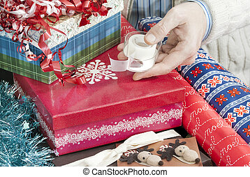 Man Holds Christmas Gift Wrapping Tape - Close-up of a man's...