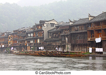 Boats and wooden houses at Phoenix Town - Fenghuang ancient...