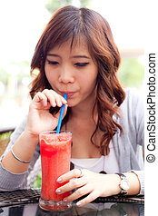 Woman drinking fruit shakes. - Woman drinking fruit shakes...