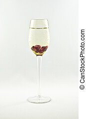 Sparkling wine garnished with pomegranate seeds