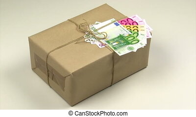Stimulus package - Brown package with euro notes on a...