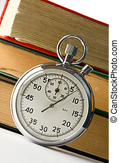 Stopwatch and a pile of old books