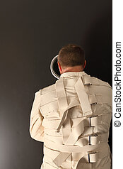 Waiting in a straitjacket - Photo of a insane man in his...