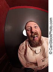 Insane man in a straitjacket - Photo of a insane man in his...