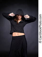 Young woman in hip hop style with hood on the head -...