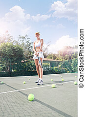 player - view of female tennis player on color back