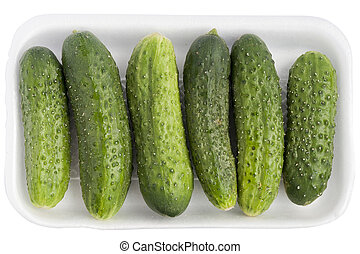 Limp old green cucumbers in a isolatedwhite plastic...