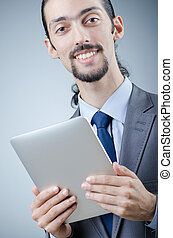 Businessman working on tablet computer