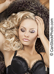 sensual woman with blond curly hair