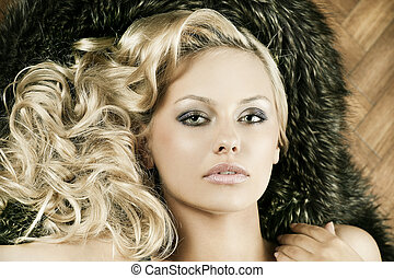 alluring sensual girl with blond curly hair