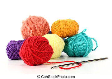 wool - colorful balls of wool with crochet hook on a white...