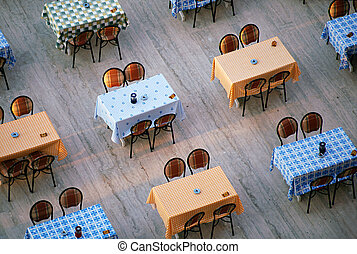 Alignement of restaurant tables and chairs - Looking down on...