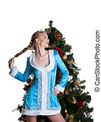 Sexy christmas girl stand with new year fir tree