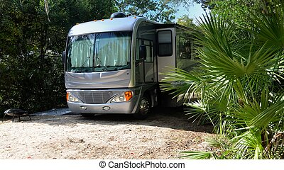 motorhome at camp site - motorhome parked at campground site...