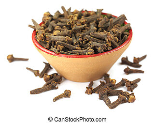 Cloves on clay pot over white background