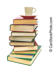 stack of books and coffee cup on white background - a large...