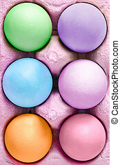 colored easter eggs in a box as a close up