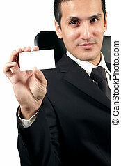 Young businessman showing a blank card
