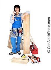 Female construction worker talking on the phone
