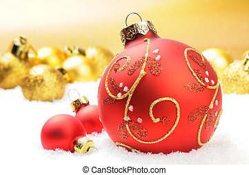 Red Christmas balls on golden background