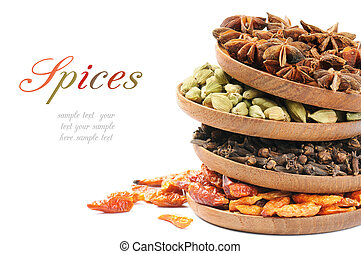 Colorful mix of spices over white