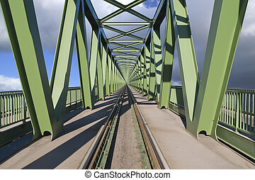 To the sky - Railroad bridge, on a sunny day, with...
