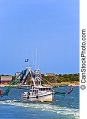 small fishing boat heading out - small fishing boat heading...