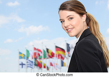 Businesswoman in front of flags